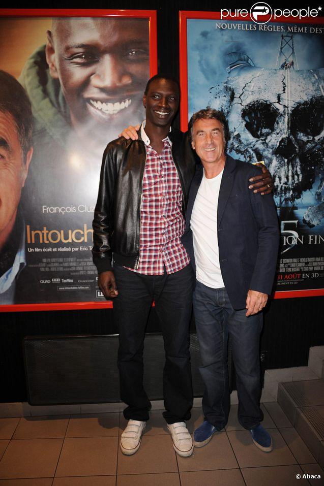 Omar Sy et François Cluzet lors de l'avant-première du film Intouchables au festival du film francophone d'Angoulême le 24 août 2011