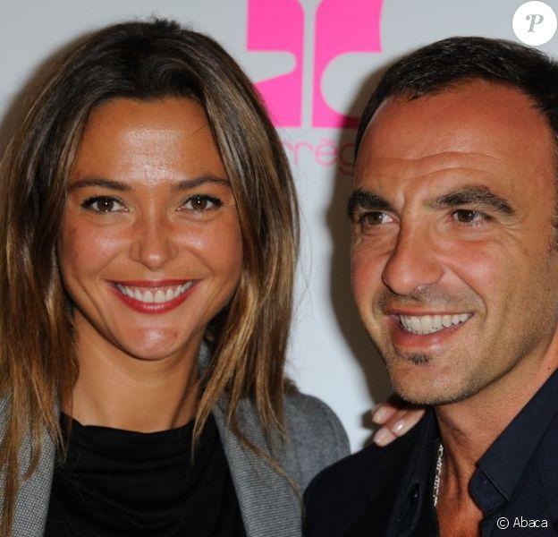 Nikos Aliagas et Sandrine Quetier assistent à la Vogue Fashion Night dans la boutique Courreges à Pairs, le 8 septembre 2011