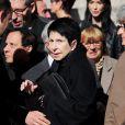 Zizi Jeanmaire et Azzedine Alaïa (à gauche) à la sortie de la messe en hommage à son époux Roland Petit en l'église St Roch à Paris, le 23 septembre 2011. Le chorégraphe est décédé le 10 juillet dernier à Genève.