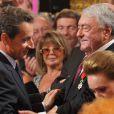 Nicolas Sarkozy décore onze personnalités intellectuelles et du monde du spectacle, ici Claude Lanzmann, à l'Élysée, le 28 septembre 2011.