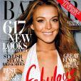 L'actrice Lindsay Lohan dépose un large et rayonnant sourire en couverture du Harper's Bazaar. Décembre 2008.