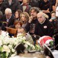 Paolo, Rossella et Martina lors de l'enterrement de leur jeune fils Marco Simoncelli le 27 octobre 2011 à Coriano