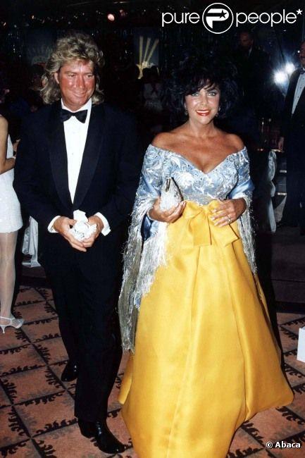 Elizabeth Taylor et Larry Fortensky, le 1er décembre 1997 à Los Angeles (archives).