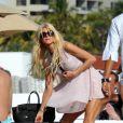 Victoria Silvstedt est à Miami pour les fêtes de fin d'année en compagnie du fils de son compagnon Maurice le 26 décembre 2011