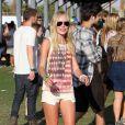 Kate Bosworth, ultra stylée dans un débardeur Topshop, un mini short Current/Elliott et des baskets Isabel Marant au Festival d'Art et de Musique de Coachella.