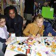 Lorie, Christian Karembeu et Bernadette Chirac lors du lancement de la 23ème opération Pièces Jaunes, à l'hôpital de Garches, le 5 janvier 2012