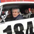 Claude Lelouch à bord de sa Ford Mustang participait à la 12e Traversée de Paris, le 8 janvier 2012.