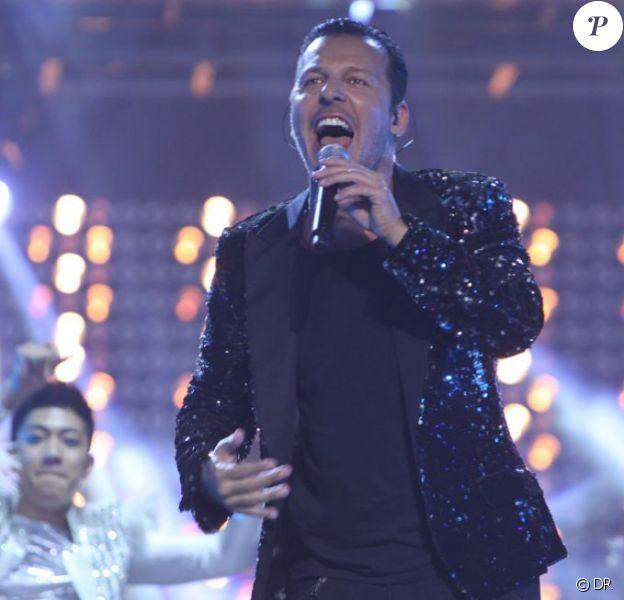 Jean-Roch : une vraie star lorsqu'il met le feu sur scène au stade de Wuhan à Shangaï lors d'un concert hors norme retransmis et organisé par la chaine JSTV le 31 décembre 2011