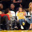 Heidi Klum, Seal et leurs enfants à un match des Lakers juste avant l'annonce de leur rupture. Los Angeles, le 7 janvier 2012.