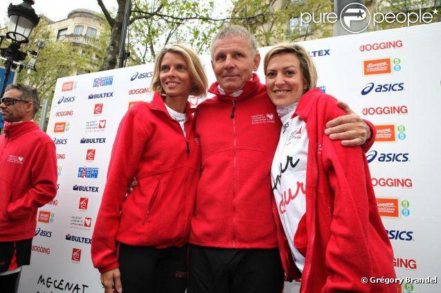 Sylvie Tellier et Patrick Poivre-d'Arvor lors des Kilomètres du Coeur, en plein Marathon de Paris le 15 avril 2012