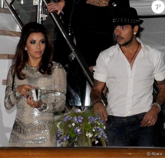 Eva Longoria et son compagnon Eduardo Cruz quittent la Sphère Party à Cannes, le 18 mai 2012.