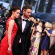 Kristen Stewart et Tom Sturridge lors de la montée des marches du Palais des Festivals pour Cosmopolis à Cannes le 25 mai 2012