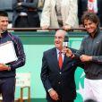 Rafael Nadal heureux le 11 juin 2012 après avoir décrocher un septième titre à Roland-Garros après avoir battu Novak Djokovic (6-4, 6-3, 2-6, 7-5)