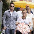 Hilary Duff se promène à New York avec son mari Mike Comrie et leur petit Luca, quatre mois, le vendredi 13 juillet 2012.