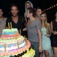 Tous les Secretistes de la saison 6, réunis autour du gâteau, fêtent l'anniversaire de Thomas (Secret Story 6), le samedi 22 septembre 2012 au Loft Metropolis, à Rungis, près de Paris.