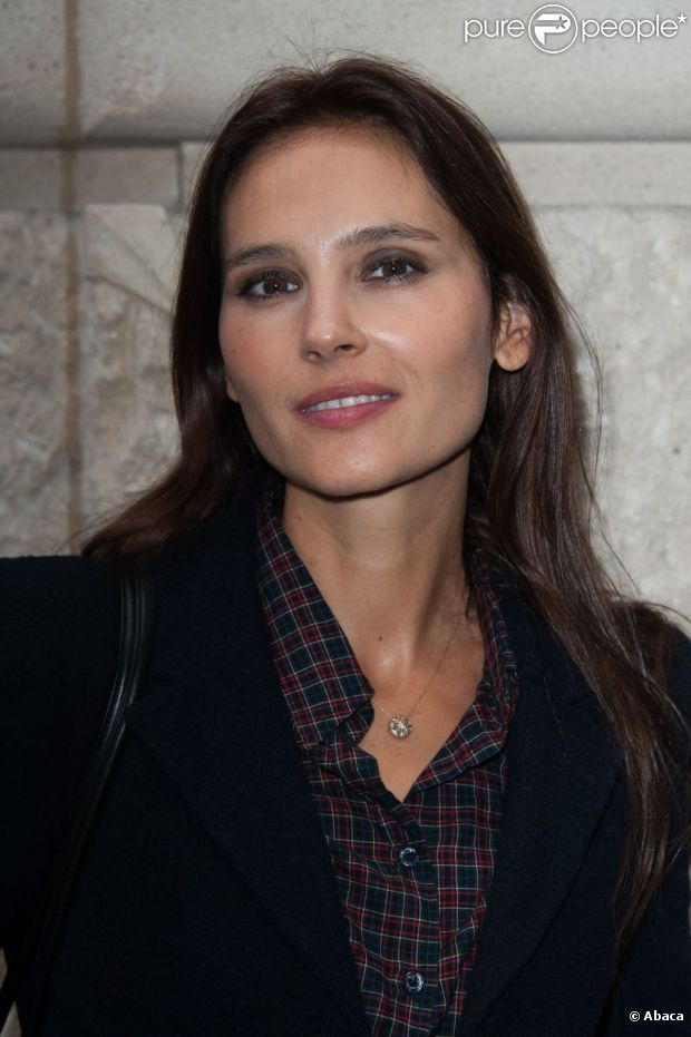 Virginie Ledoyen assiste au défilé Paul & Joe printemps-été 2013 au Pavillon Cambon. Paris, le 2 octobre 2012.