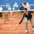 Novak Djokovic a passé quelques jours à Rio en compagnie de Gustavo Kuerten, entre match exhibition et inauguration de courts de tennis dans les Favelas, le 17 novembre 2012