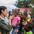 Sonia Rolland était en voyage humanitaire au Rwanda, son pays d'origine, fin novembre - début décembre 2012 pour le compte de son association Maïsha Africa. Elle tient ici dans ses bras la petite Ornella, 2 ans, abandonnée par sa mère et qui est atteinte d'une maladie grave.