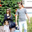 Scott Disick, sa compagne Kourtney Kardashian et leur fils Mason à Miami. Le 14 décembre 2012.