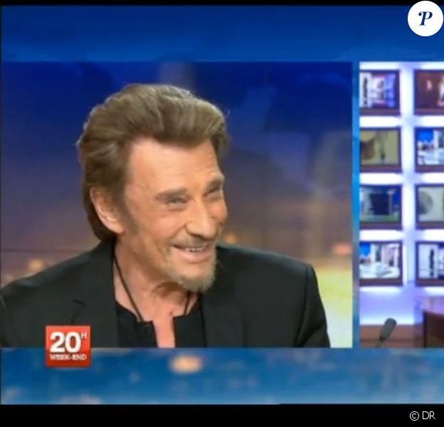 Johnny Hallyday face à Laurent Delahousse sur le plateau du 20 heures de France 2, le 9 février 2013.