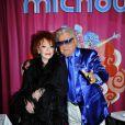 Michou prend la pose au côté de Régine lors de la soirée  Regine's Birthday  afin de célébrer les 83 ans de Régine. La soirée s'est déroulée dans le cabaret de Michou à Paris, le 12 février 2013.