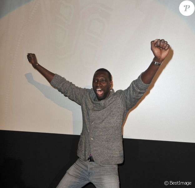 Omar Sy heureux à la première du film De l'autre côté du périph à Berlin le 17 mars 2013.