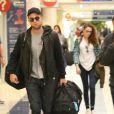 Robert Pattinson et Kristen Stewart à l'aéroport de Los Angeles le 26 novembre 2012.