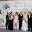 La princesse Charlene de Monaco, vêtue d'une robe Ralph Lauren, a gardé sa veste le temps du photocall du Bal de la Rose au Sporting de Monte-Carlo, samedi 23 mars 2013