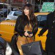 Kim Kardashian, enceinte, va faire du shopping à New York, le 26 mars 2013.