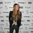 Elle Macpherson lors de la levée de fonds pour le programme The Dog Jogger de Barry Karacostas au 3 Cromwell Road. Londres, le 26 mars 2013.