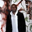 """L'artiste Barthélémy Toguo - Vernissage de l'exposition """"Galopec ou les sept péchés capitaux à l'Espace Culturel Marc Jacquet à Barbizon, le 25 mai 2013."""