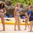 Paige Butcher, 33 ans, est aussi sexy que Bria Murphy, 23 ans et fille aînée de son conjoint, l'acteur Eddie Murphy. Hawaï, le 11 juin 2013.