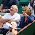 Dominique  Strauss - Kahn  et sa compagne  Myriam  L'Aouffir lors des Internationaux de France à  Roland - Garros  le 8 juin 2013.