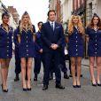 John Travolta, en très charmante compagnie pour l'inauguration de la nouvelle boutique Breitling située au 130 New Bond Street à Londres. Le 27 juin 2013.