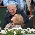 Dominique Strauss-Kahn et sa compagne Myriam L'Aouffir assistent à la victoire de Rafael Nadal lors des Internationaux de France à Roland-Garros le 9 juin 2013.