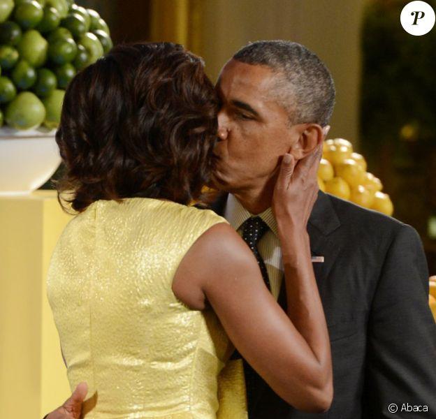 Barack Obama et son épouse Michelle Obama lors de la soirée Kids State Dinner, à la Maison-Blanche, organisée pour récompenser 50 jeunes américains dans le cadre du concours anti-obésité Healthy Lunchtime Challenge, le 9 juillet 2013.