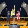 Chris Froome, vainqueur du Tour de France 2013 devant Nairo Quintana et Joaquim Rodriguez sur le podium de la Grande Boucle à Paris le 21 juillet 2013