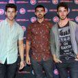 Les Jonas Brothers en concert dans les studios de la Radio Hot 99.5 à Rockville, le 29 juillet 2013.