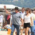 Sylvester Stallone avec sa femme Jennifer Flavin arrivant au club 55 à Saint-Tropez le 4 août 2013