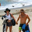 Exclusif - Ireland Baldwin et son petit ami Slater Trout sur la plage de Malibu, le 25 juillet 2013.