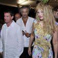 Le ministre de l'Intérieur, Manuel Valls, le philosophe Bernard-Henri Lévy et sa femme l'actrice Arielle Dombasle après le concert du 'Travelling Quartet' d'Anne Gravoin, dans le cadre du Off du 64e Festival de Musique de Menton, dans le sud de la France le 5 août 2013.