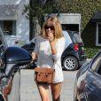 Lauren Conrad, sexy à Los Angeles, assortit son sac Cambridge à ses bottines Rag & Bone. Los Angeles, le 2 août 2013.