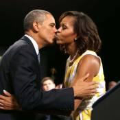Barack Obama et Michelle s'offrent un beau baiser avant de partir en vacances