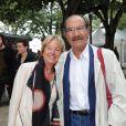 Gérard Hernandez et sa femme se promènent durant le 15e Festival de la Fiction TV de La Rochelle. Le 12 septembre 2013.