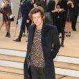 Harry Styles arrive au défilé de mode Burberry Prorsum, collection printemps-été 2014, lors de la fashion week de Londres. Le 16 septembre 2013