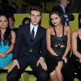 L'acteur canadien Nolan Funk et Selena Gomez au défilé Versace printemps-été 2014 à Milan, le 20 septembre 2013.