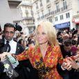 Pamela Anderson lors du défilé Vivienne Westwood printemps-été 2014 au Centorial. Paris, le 28 septembre 2013.