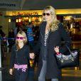 Heidi Klum et sa fille Leni à l'aéroport de New York, le 5 octobre 2013.