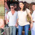 Simon Cowell et sa compagne Lauren Silverman (enceinte) dans les rues de Los Angeles, le 12 octobre 2013.