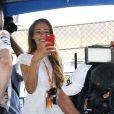 Jessica Michibata dans le paddock du Grand Prix du Japon à Suzuka le 13 octobre 2013